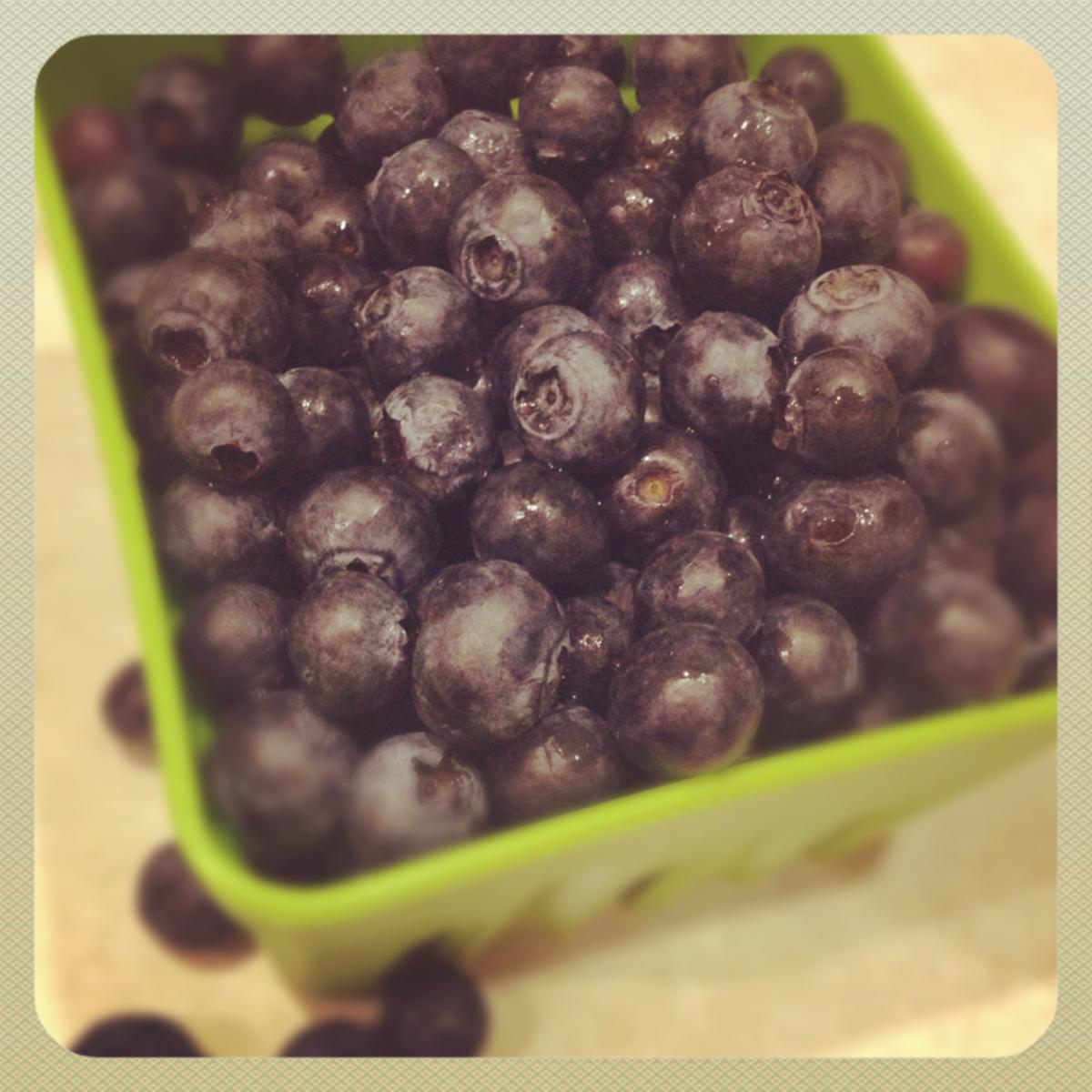 Fresh berries in cute carton.