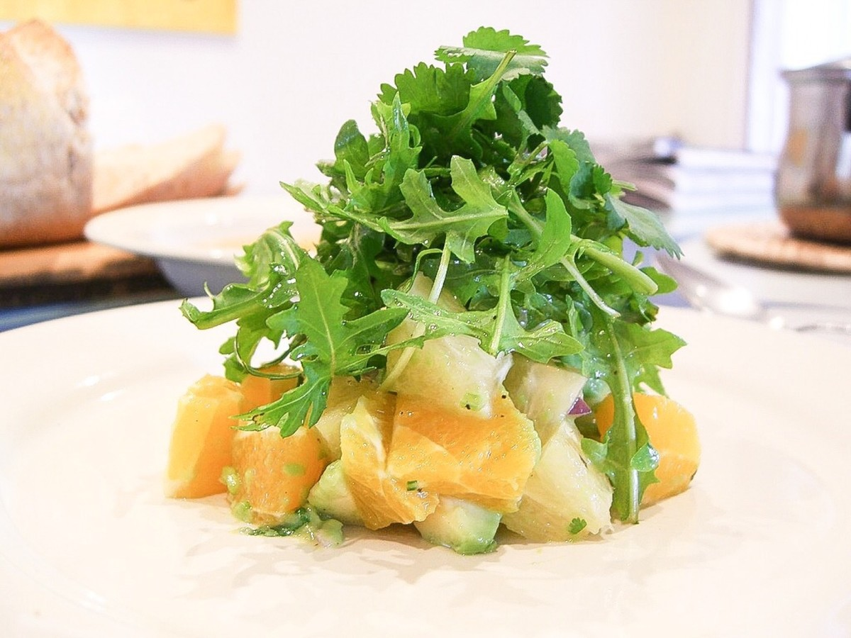Avocado, grapefuit and orange salad with red onion, arugula and cilantro