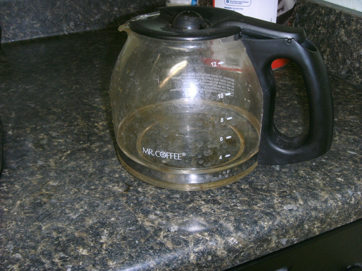 Add two cups of white vinegar to the carafe,