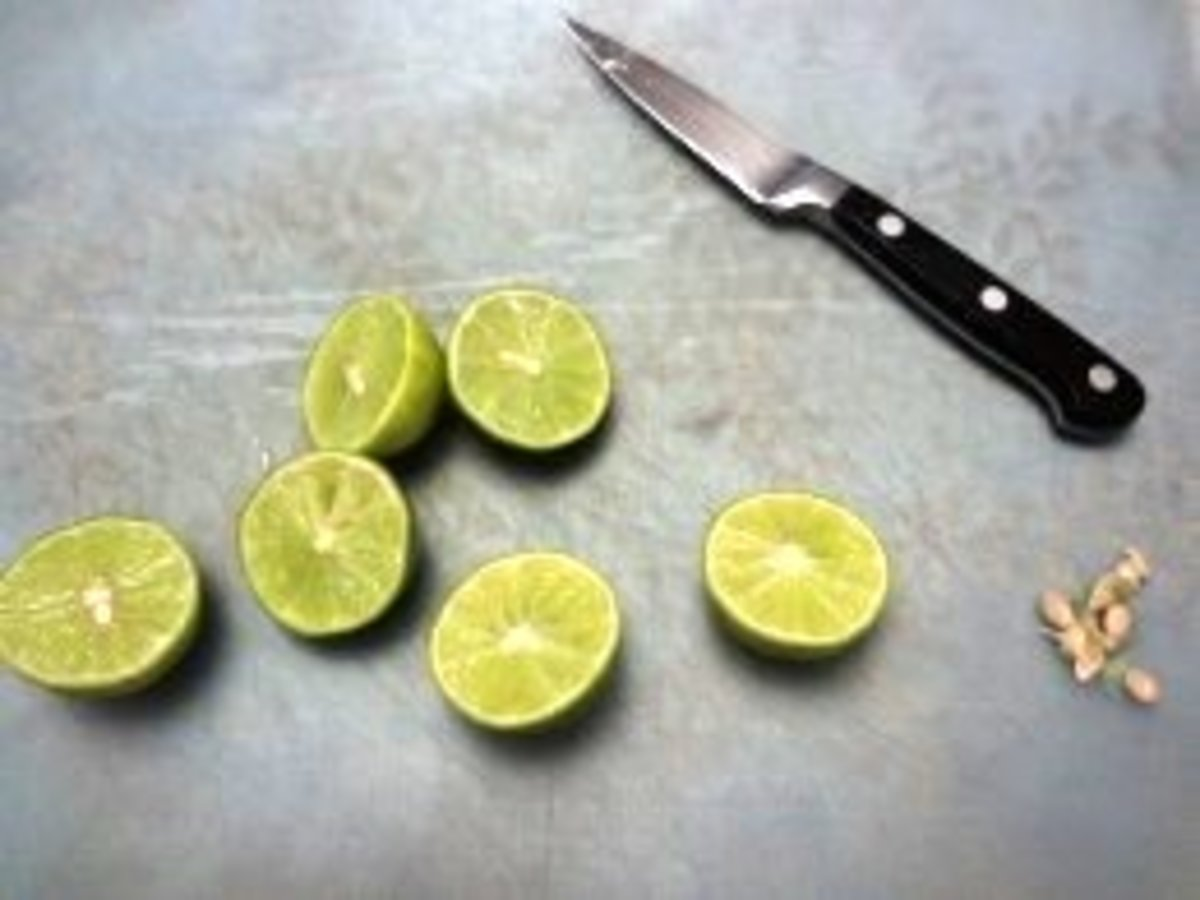 Cut Key limes in half and remove seeds