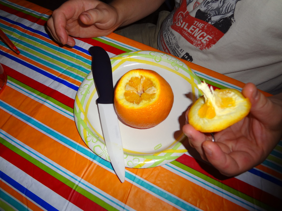 Cut off the top of the orange.