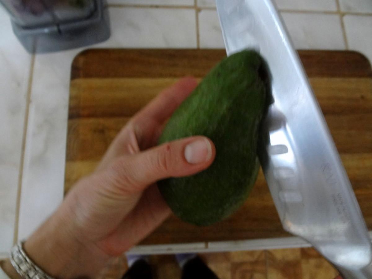 Halve the avocados.