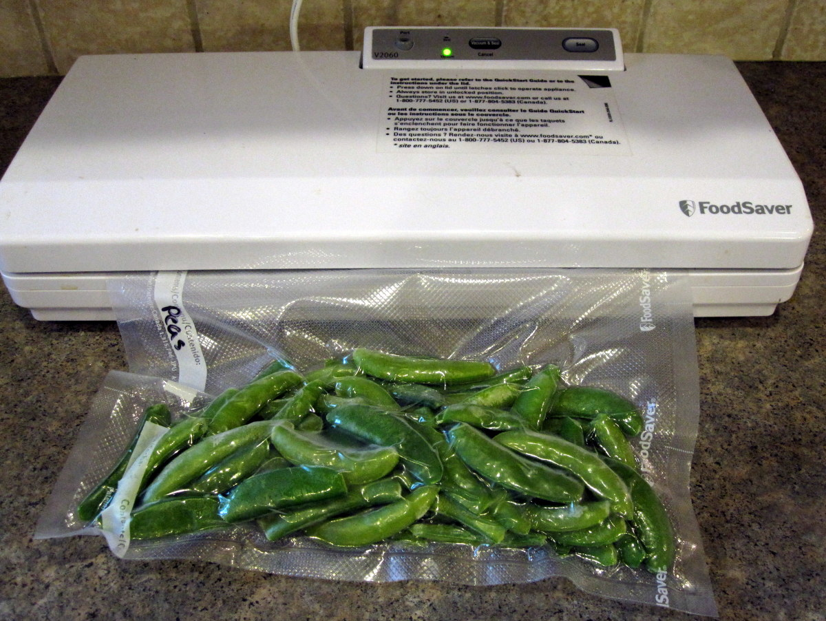 Packaging peas with a vacuum sealing machine.