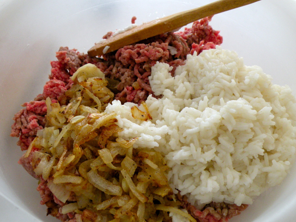 Mix sauteed onions and rice with ground beef.