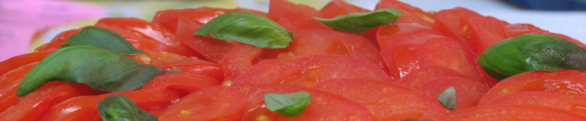 Beautiful layered tomato top, sprinkled with fresh basil.