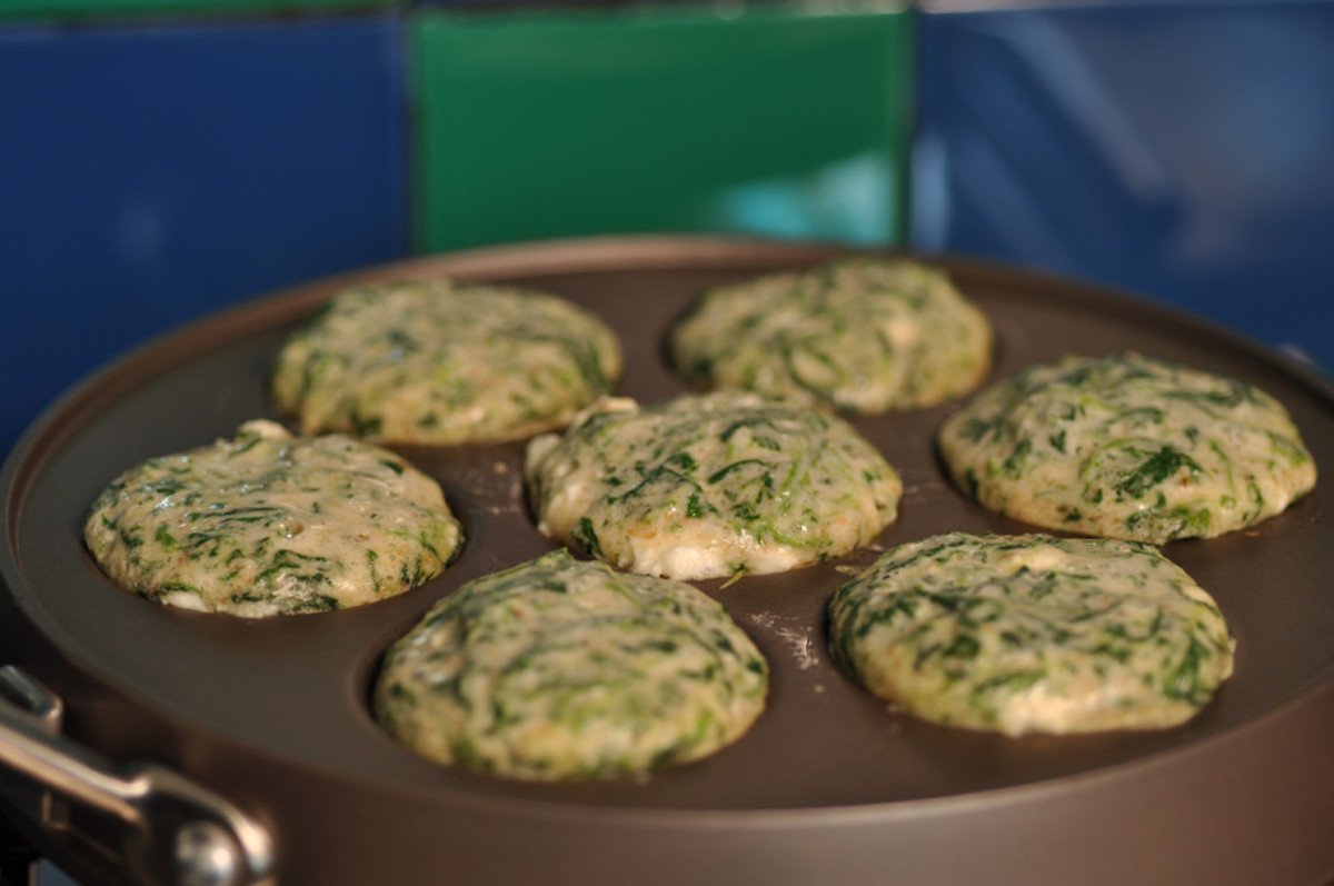 Spinach and feta ebelskivers cooking in pan. Image: © Siu Ling Hui