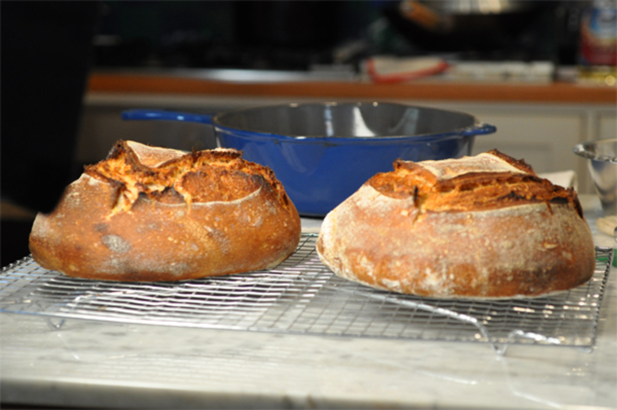 Loaves are baked in preheated cast iron casserole (with preheated lid) in very hot oven to create steam effect of baker's oven. Image: © Siu Ling Hui