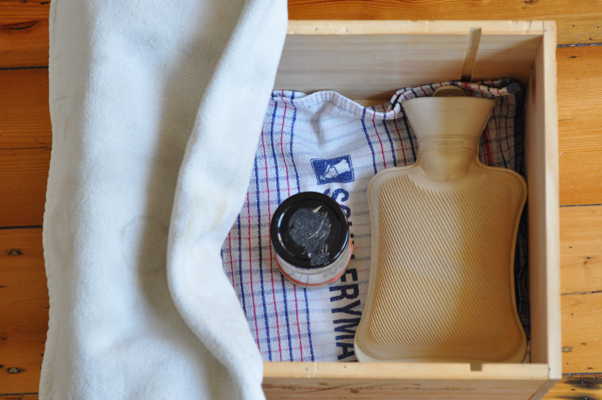 My make-shift proofing box. I put the starter or leaven in with a hot water bottle and cover with a thick oven cloth. Image: © Siu Ling Hui