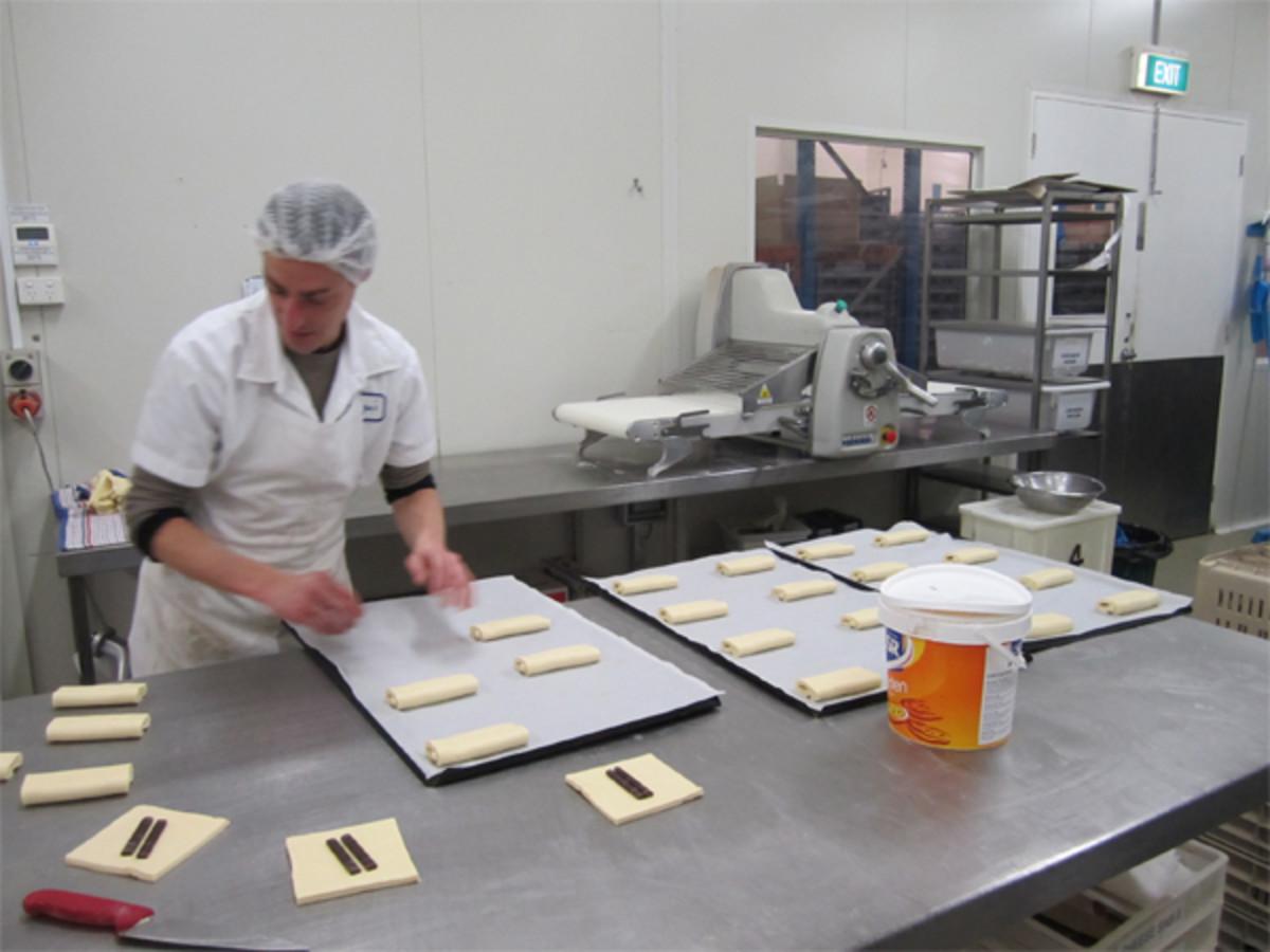 Making chocolate croissants.