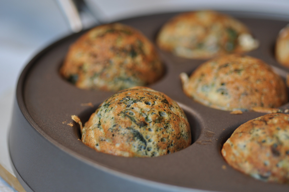 Spinach and feta ebelskivers - flipped over to complete cooking. Image: © Siu Ling Hui