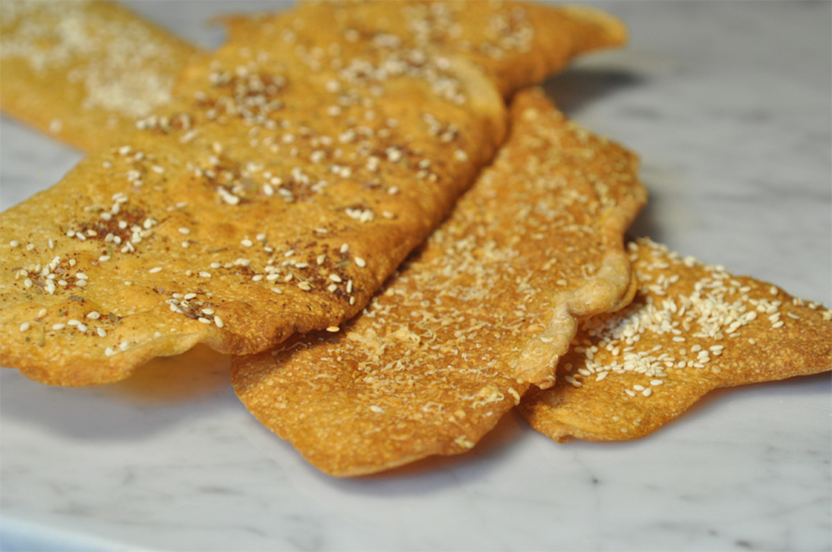 3 different flavours of Levain Crackers. Toppings are Za'atar (top), finely grated Grana Padano (middle), and Sesame Seeds (bottom).