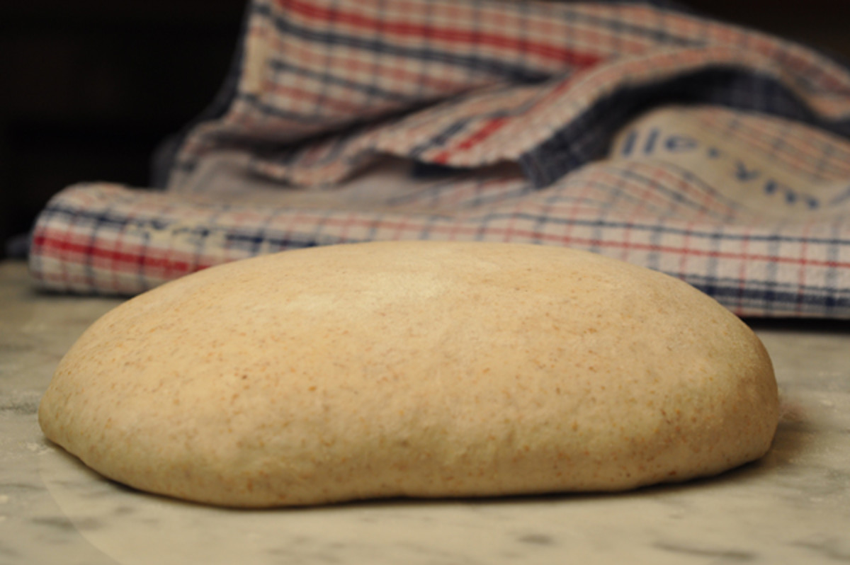 """After bulk fermentation, dough is turned out of bowl and shaped. Then covered with a light dusting of flour and a tea towel and left to undergo """"bench rest"""". For this batch, I let bench rest go for about 1 1/2 hours as the kitchen was quite cool. Ima"""