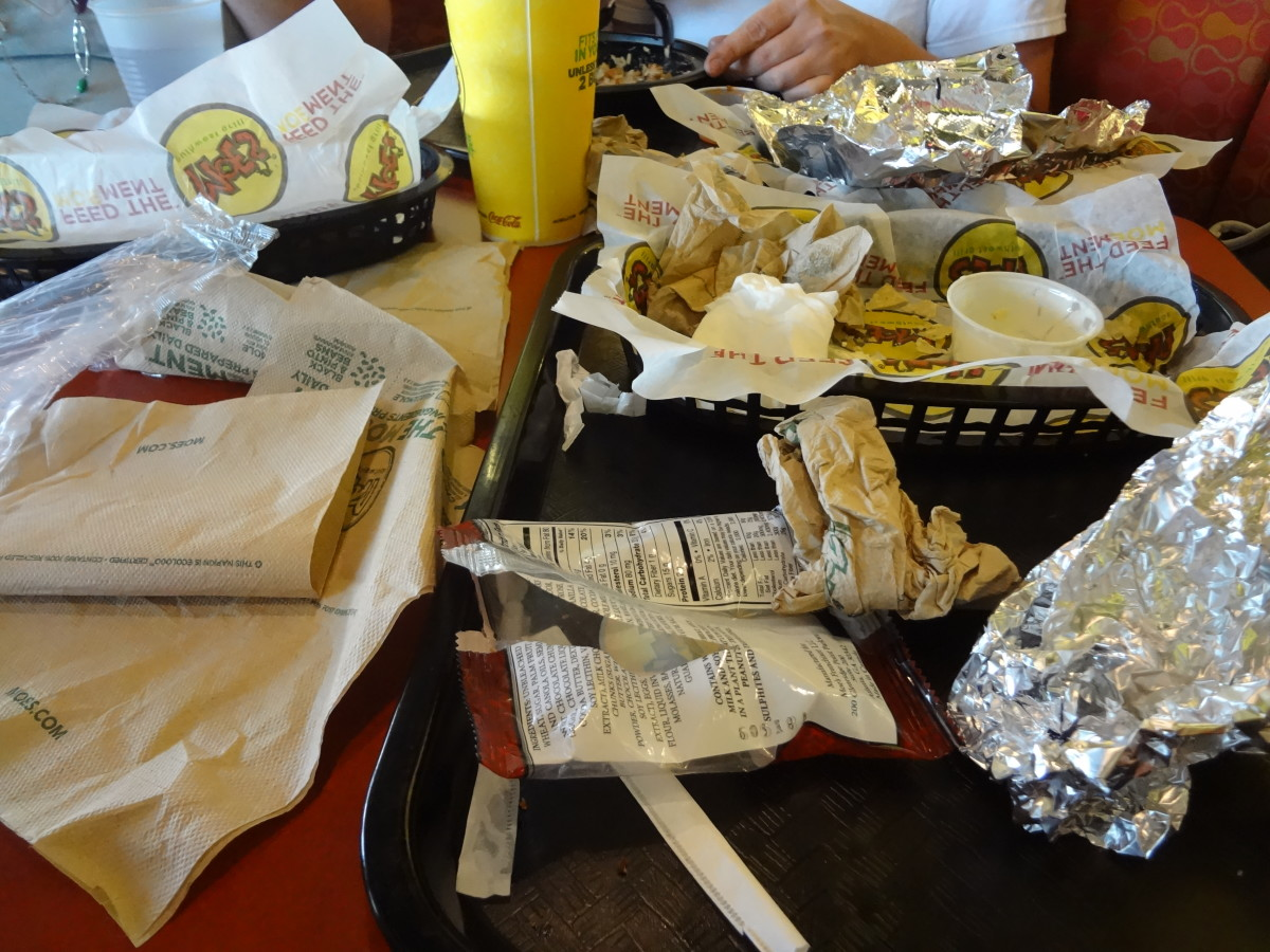 Napkins, wrappers, silverware, cups, lids, straws, and condiments.  Look at all that trash.