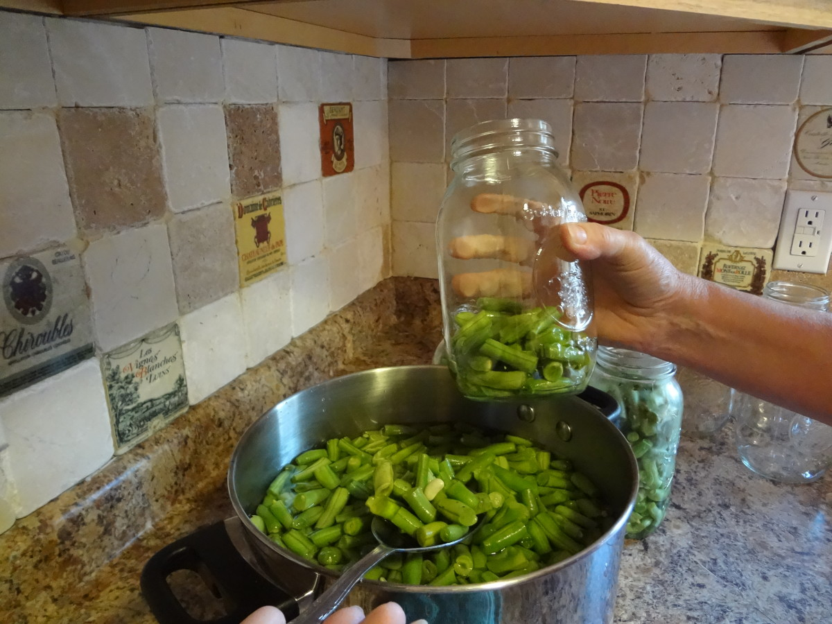 Fill the jars with the food leaving an inch or more of space at the top.