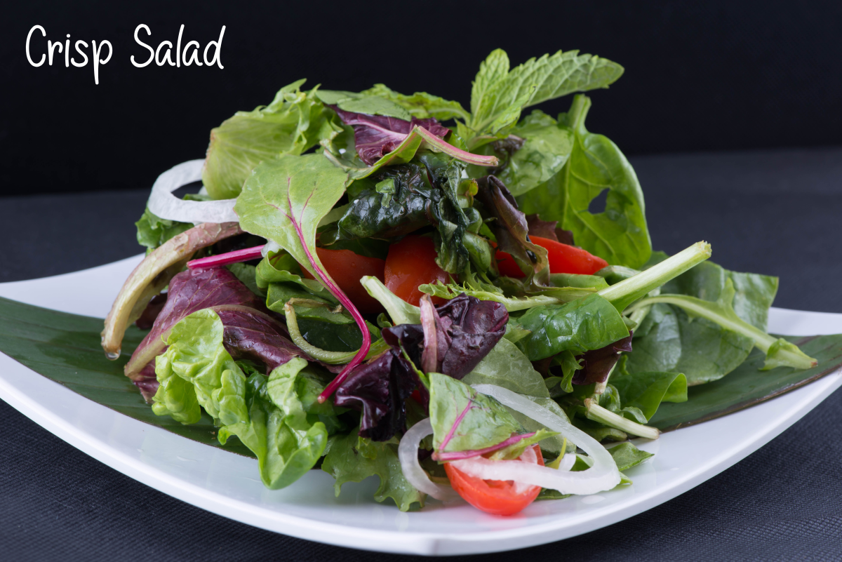 A crisp salad should be able to stand high on a plate like this photo and not be sunk down in a watery mess in a salad bowl.  Which would you rather serve to your guests?