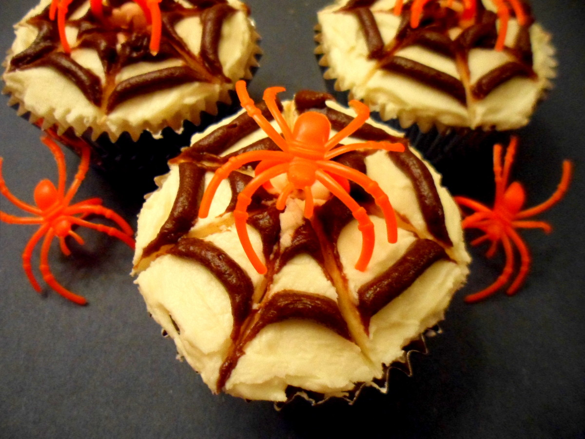 Add a plastic spider ring to finish the cupcake.