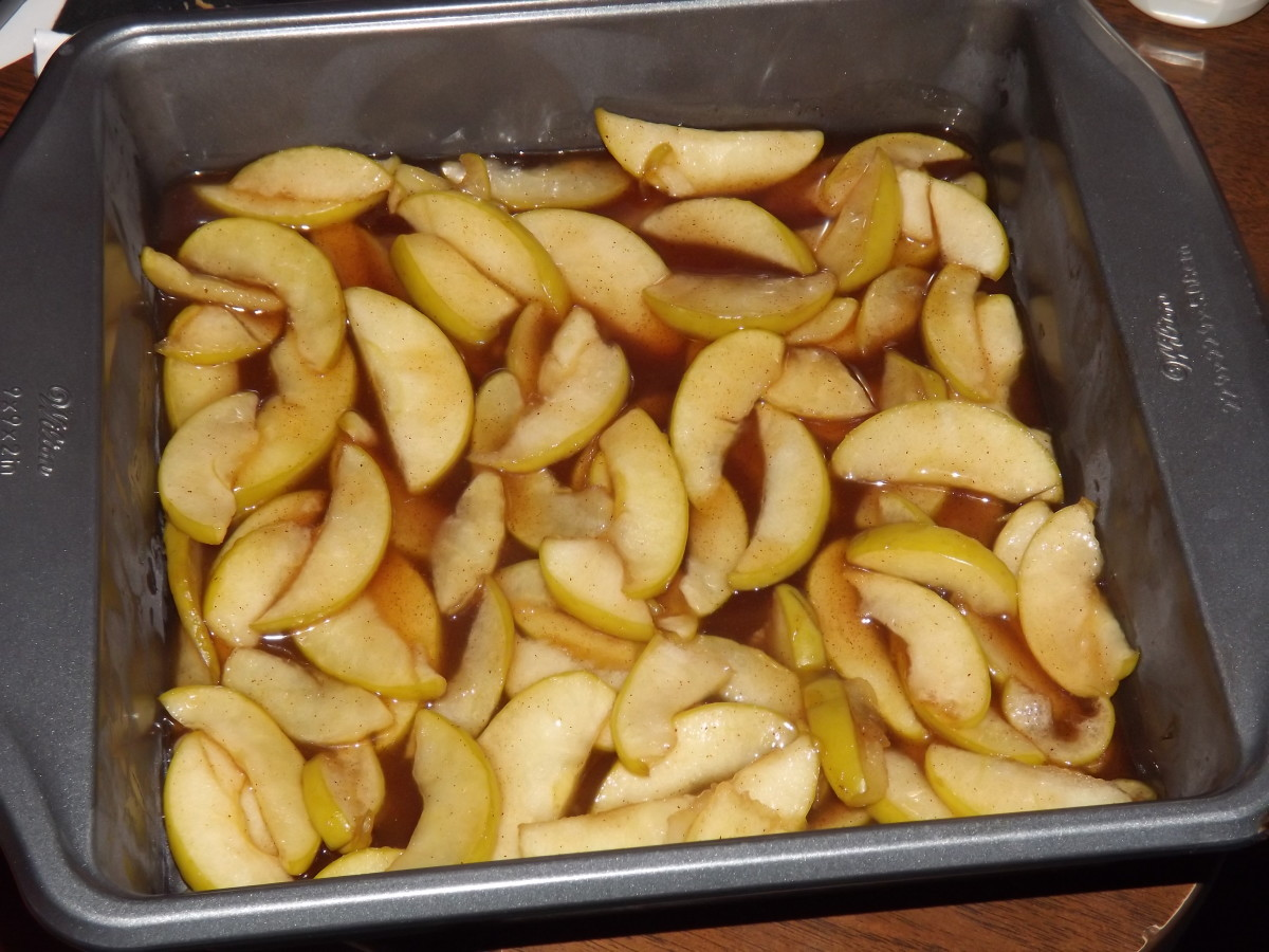 Warm apples in a baking dish.