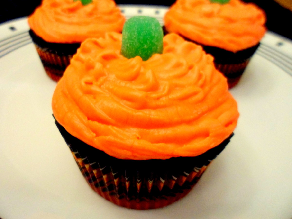 Top each cupcake with a green gum drop.