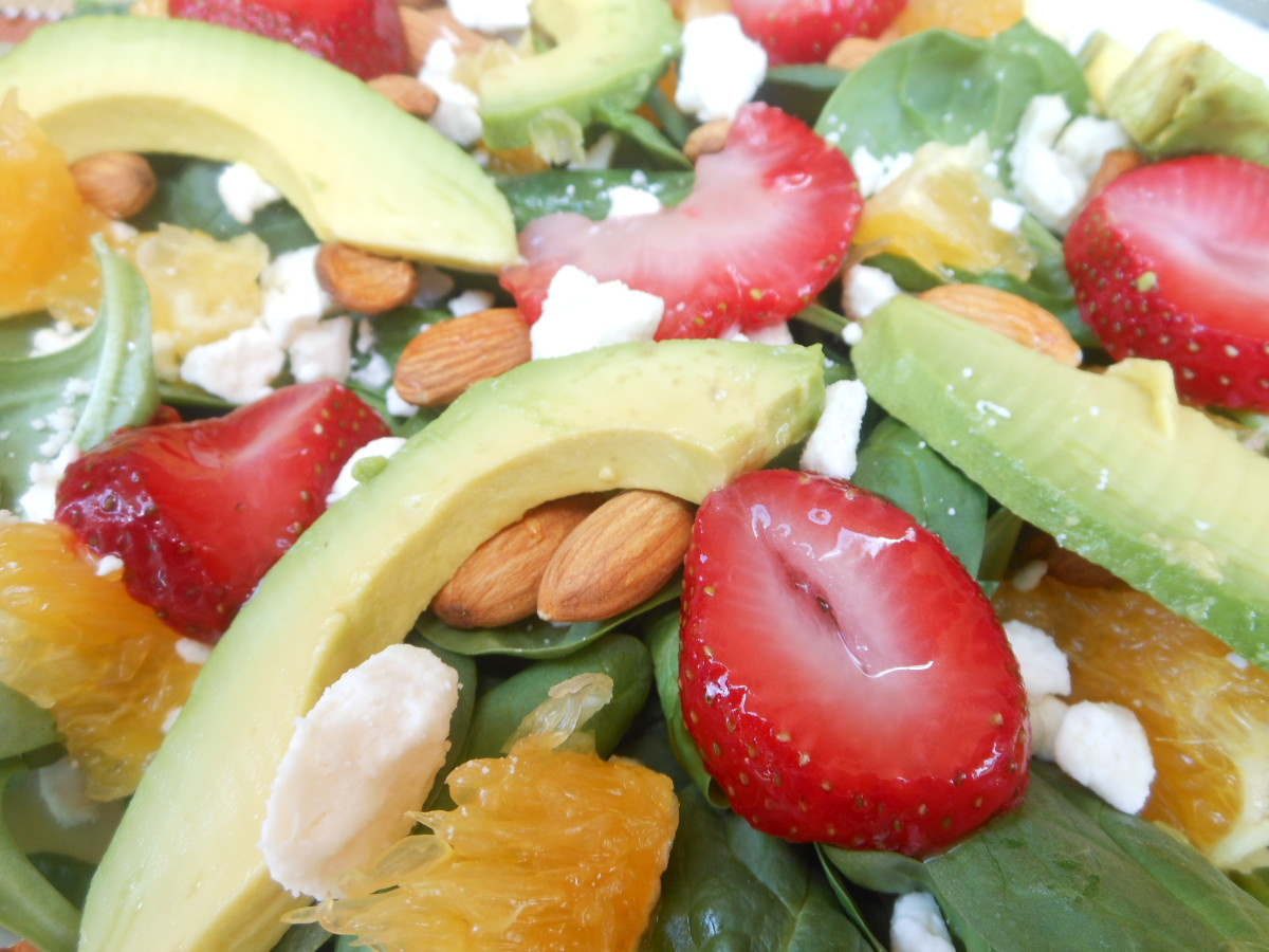 A delicious and tempting close-up of a very healthy spinach and avocado salad.