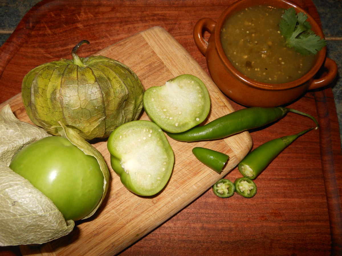 Tomatillos have a slightly sticky texture and have a thick center with seeds. They are pictured here with sliced serrano peppers.