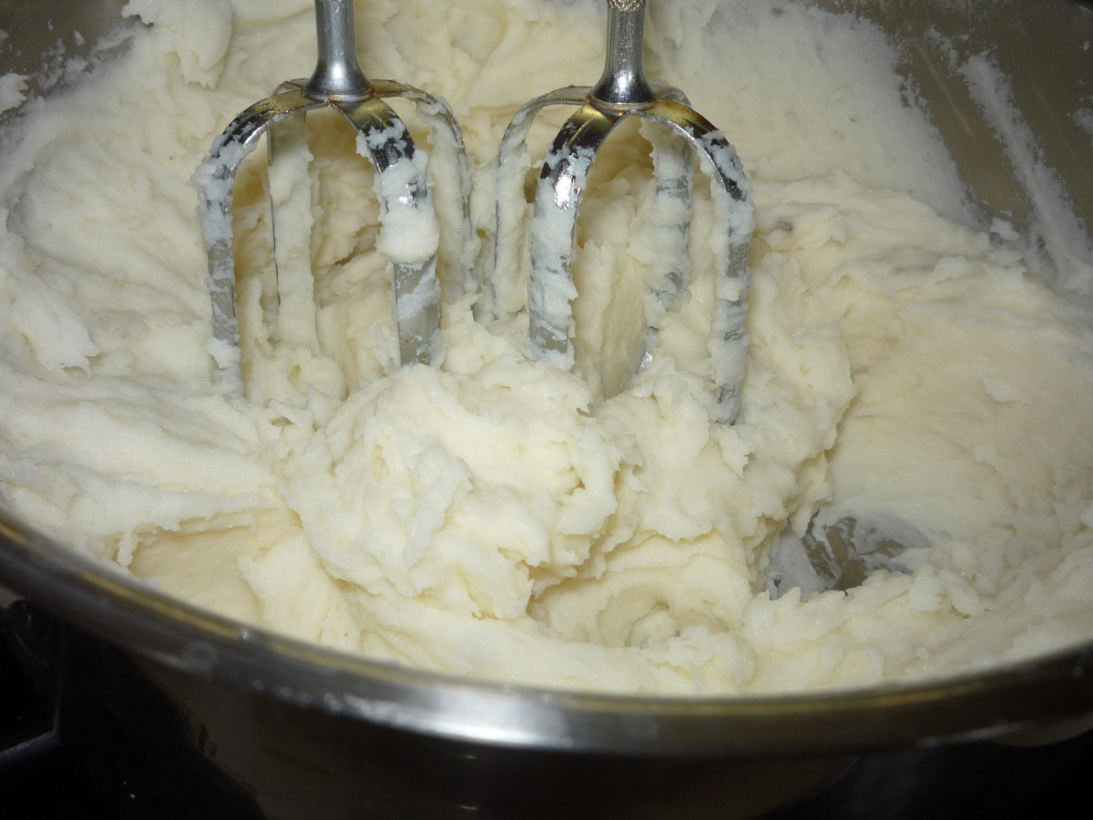 Potatoes can be mashed with a mixer, a hand potato masher or a fork.