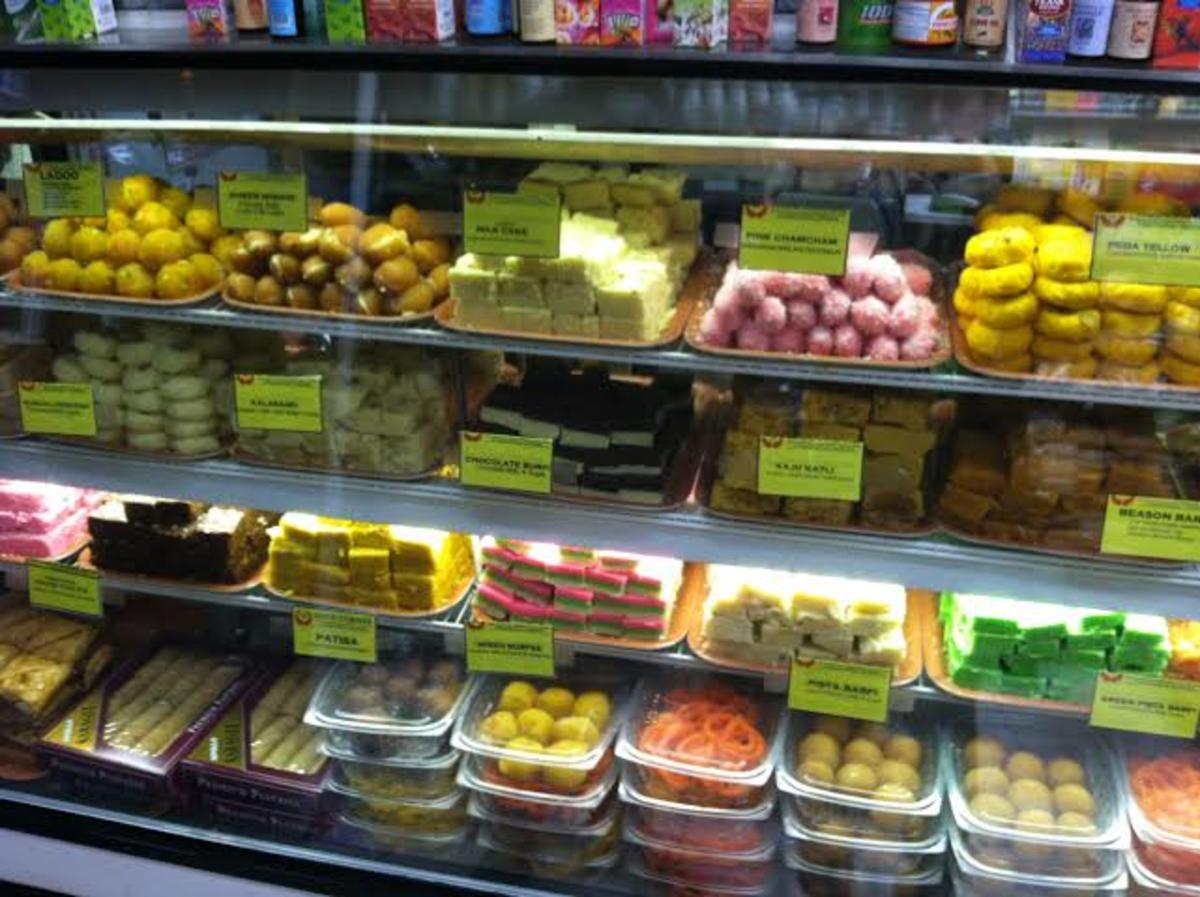 Indian sweets displayed at a sweets shop.