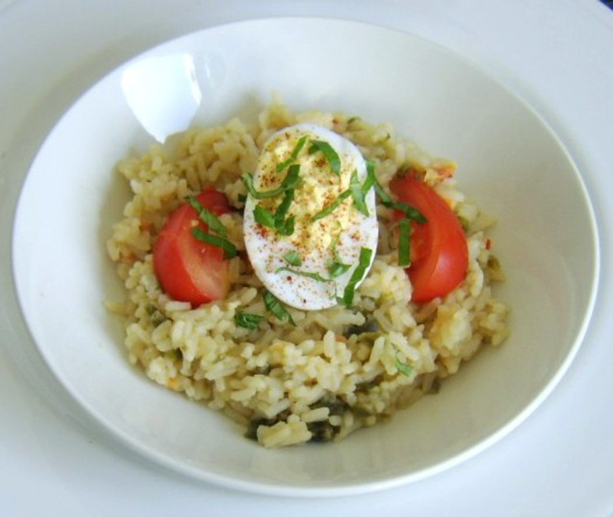 Turmeric and garlic deviled duck egg is served on a bed of Indian spiced rice