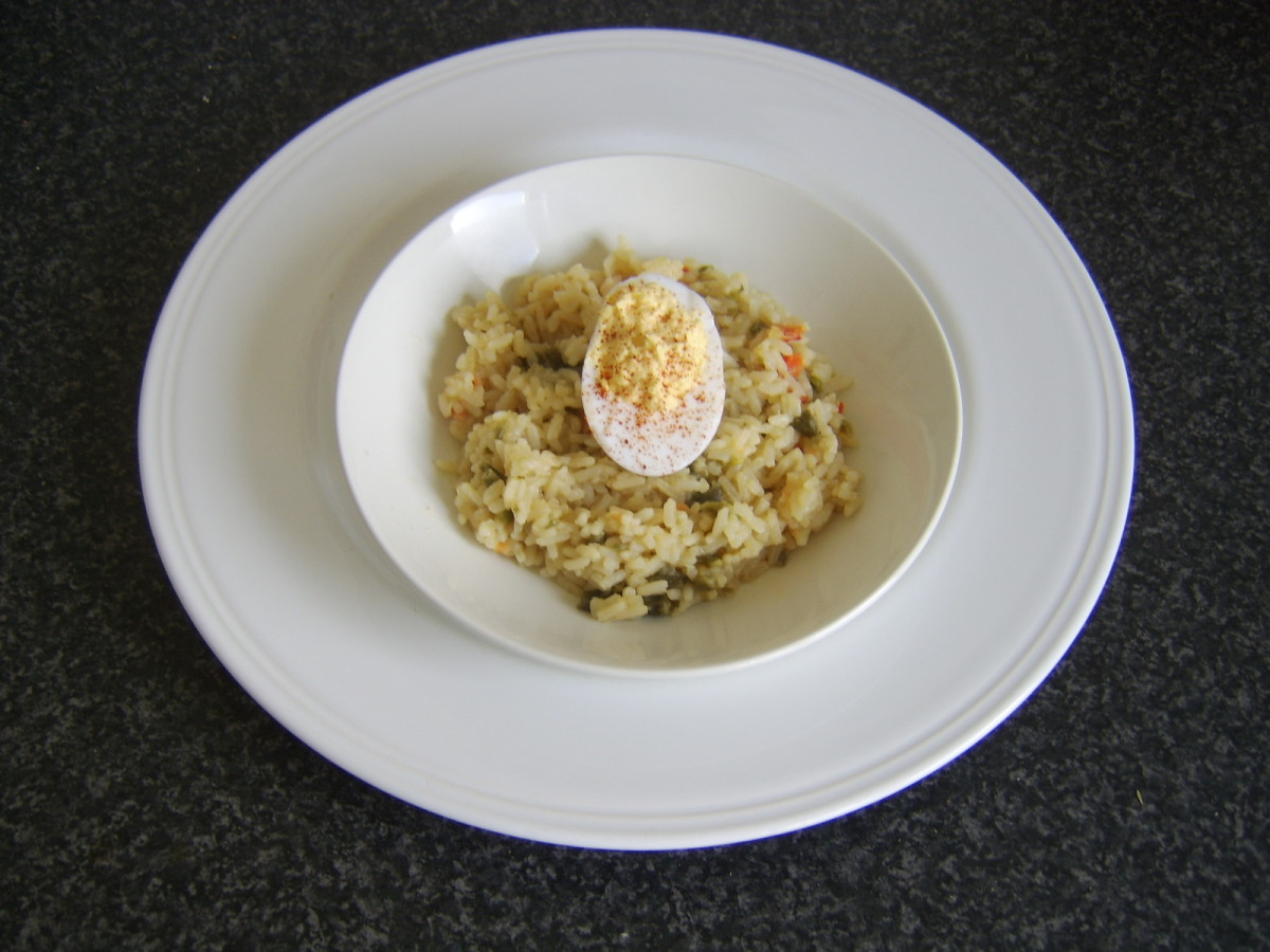 Deviled duck egg is laid on spiced rice