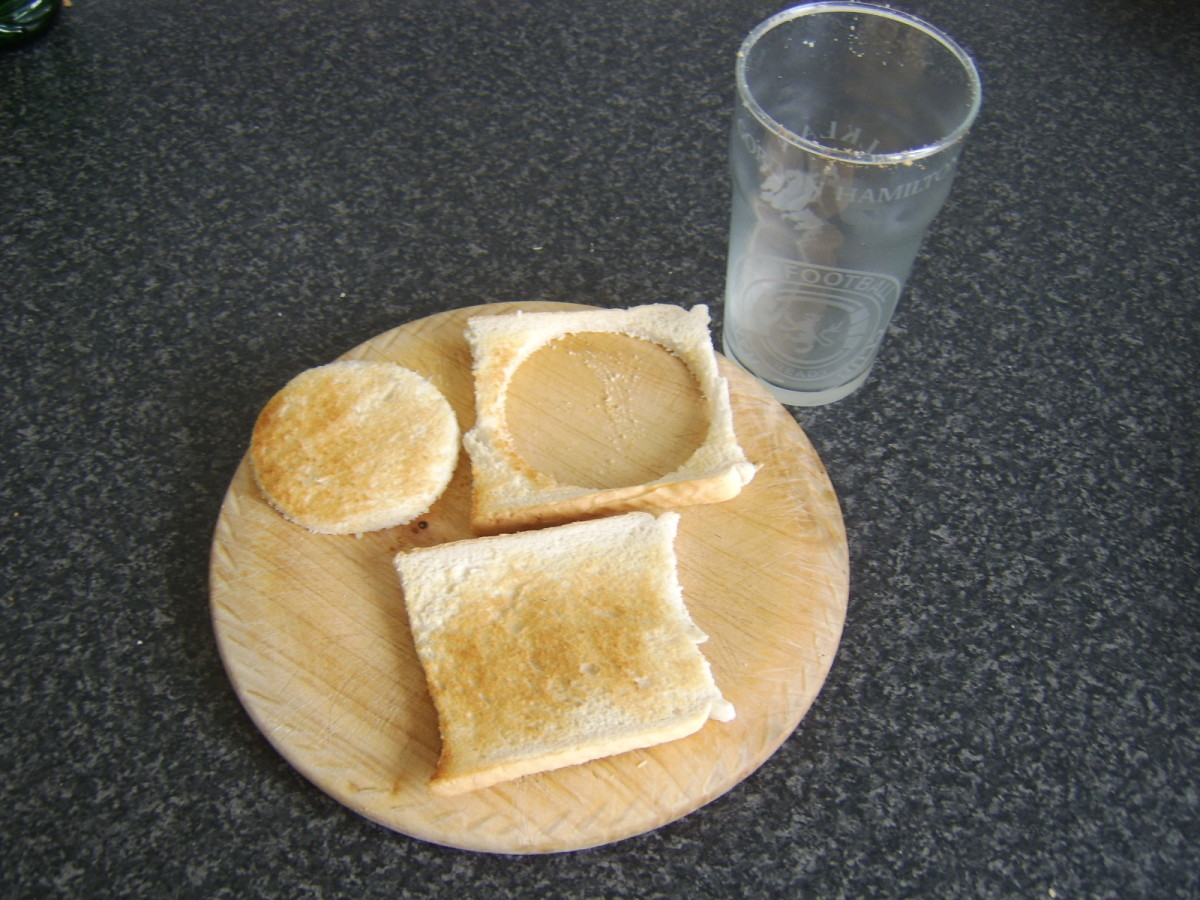 Cutting large circles from slices of toast