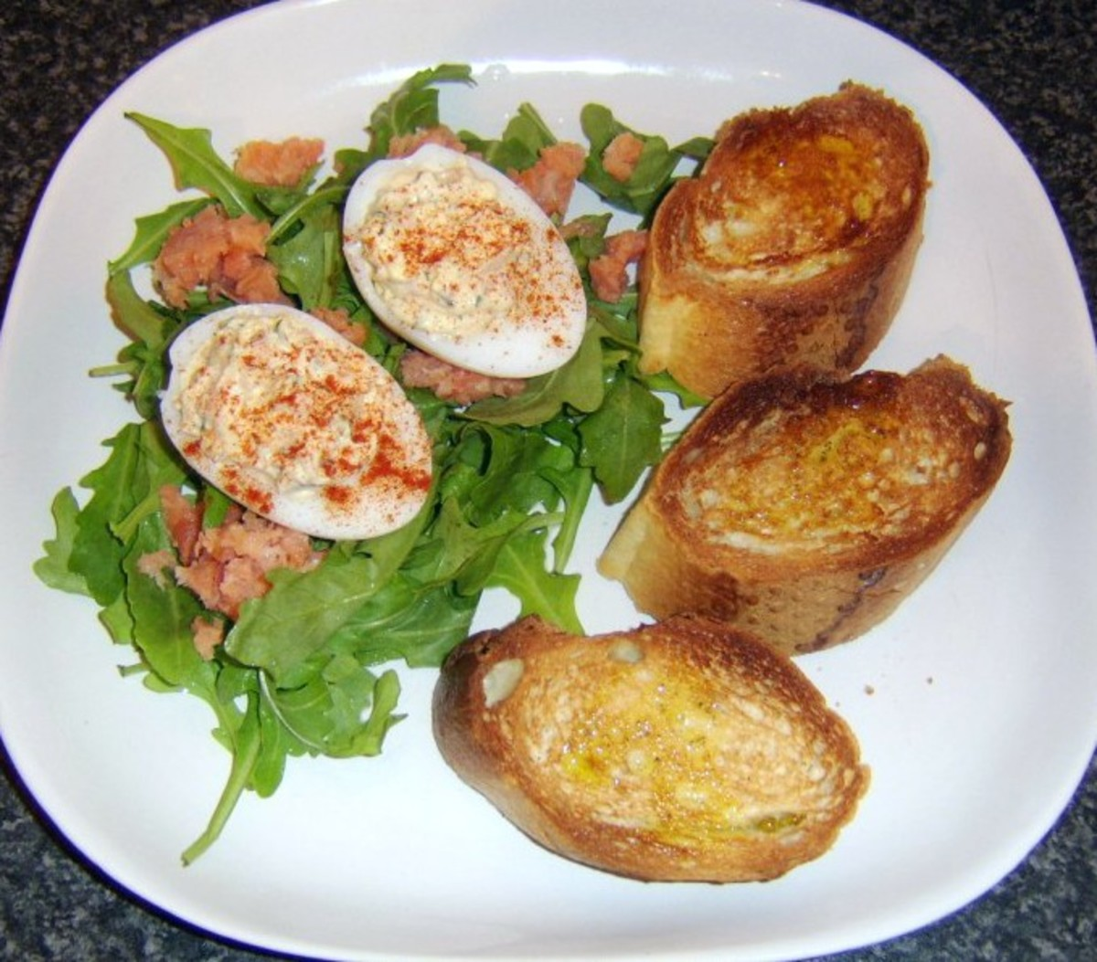 Smoked salmon is used in the deviled eggs as well as in the salad, all served with bruschetta