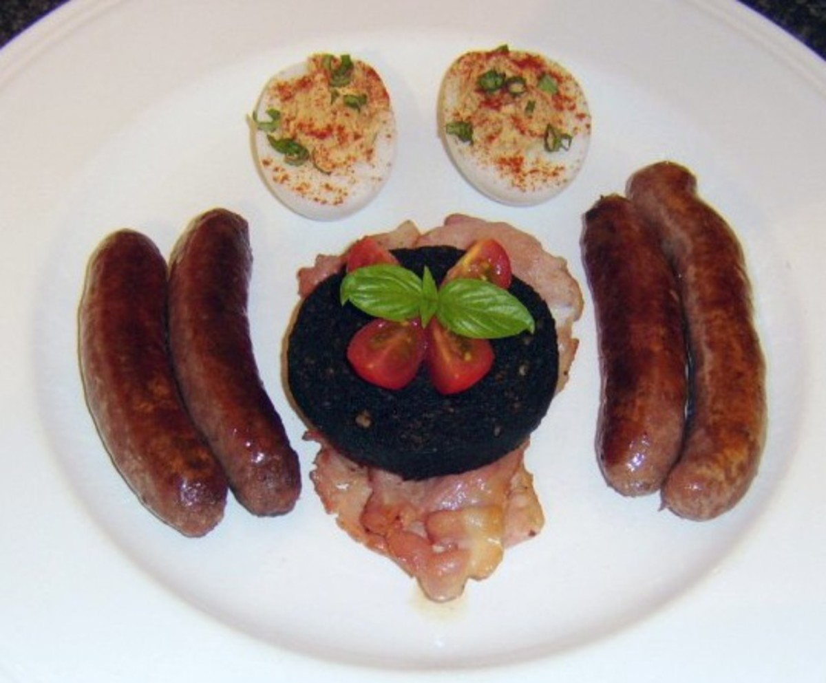 A deviled duck egg is served with several more traditional components of a fried breakfast