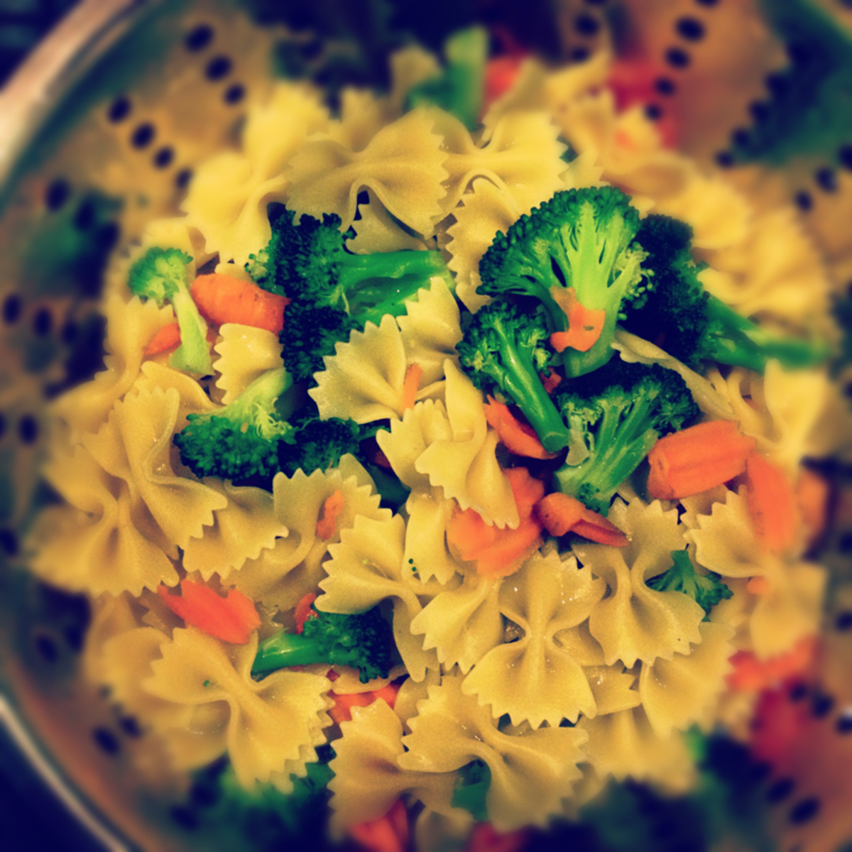 Pasta and healthy veggies in colander