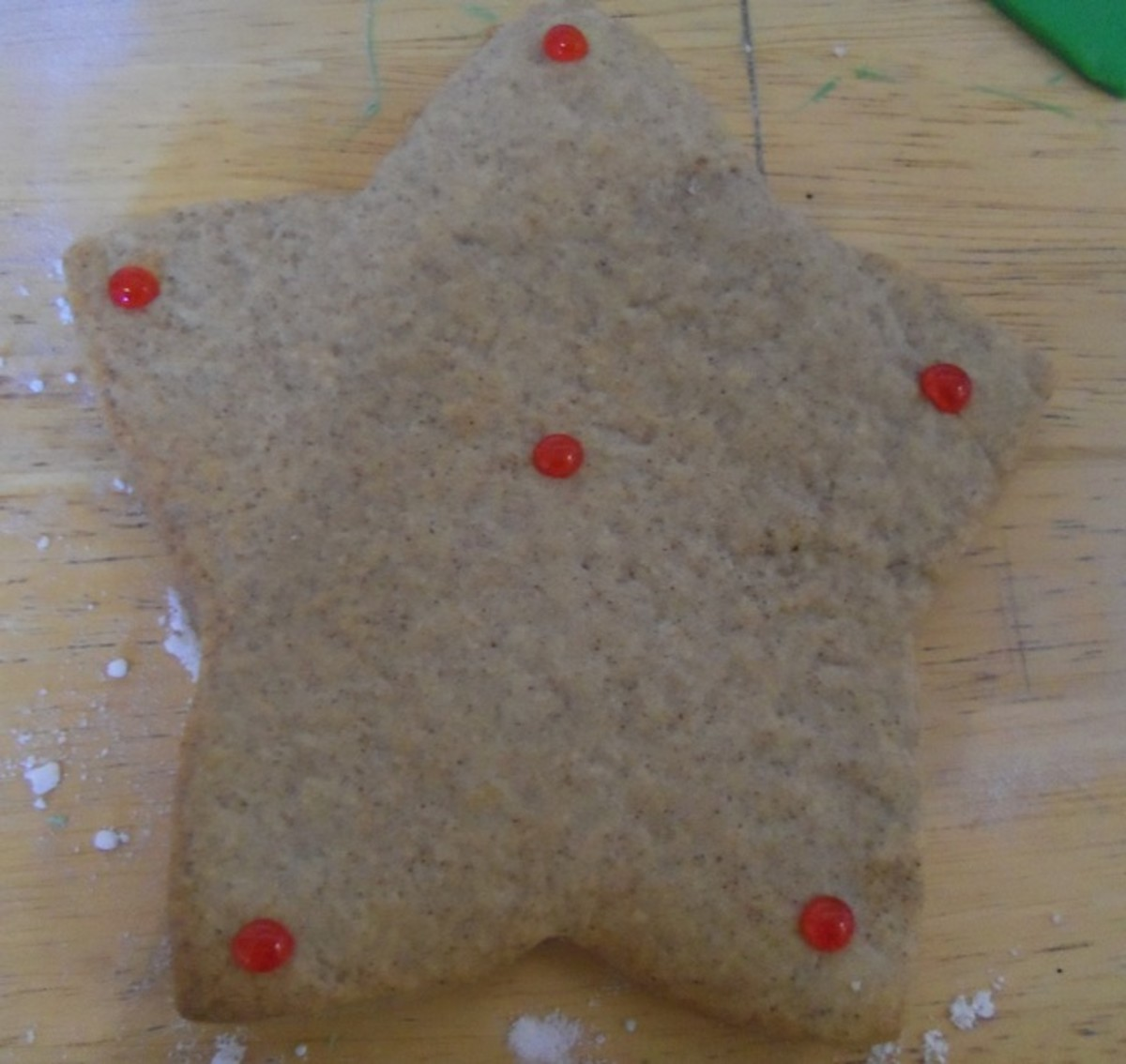 Use decorative piping gel, dotted on the cookie, as an adhesive