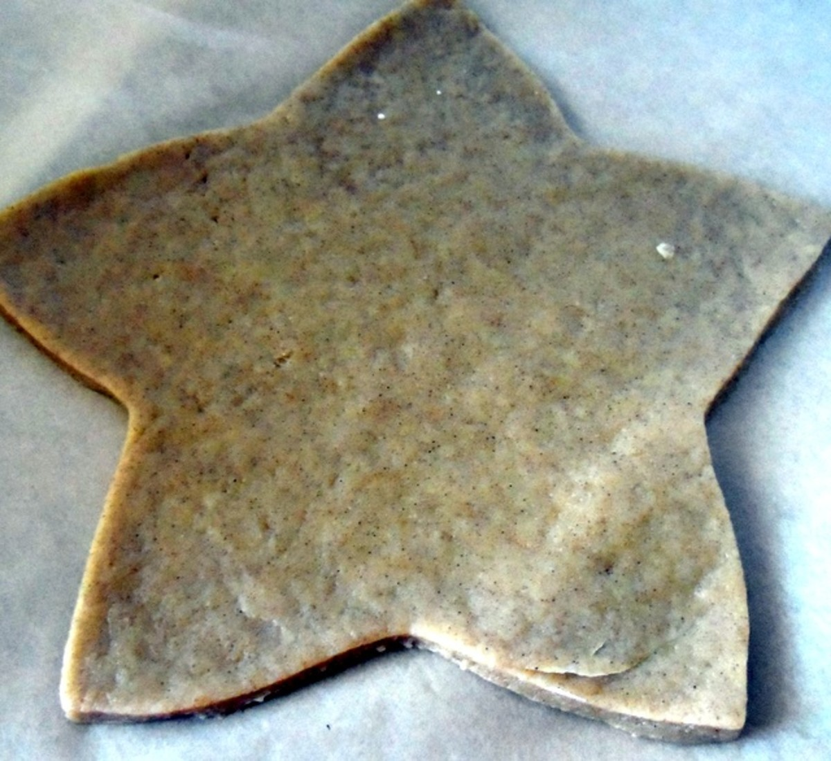 Roll out the dough and cut out the star shapes.  Place on baking sheets lined with parchment and bake in the oven.