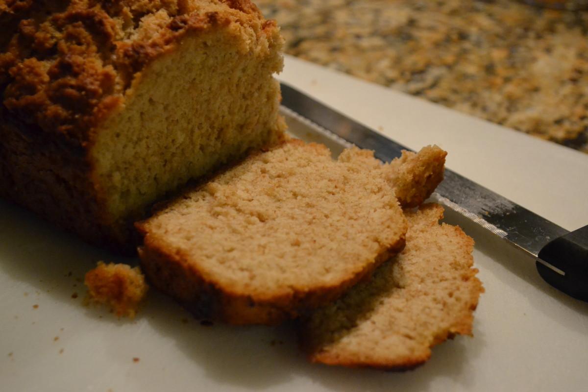 Moist, dense bread with a fluffy, crunchy top.