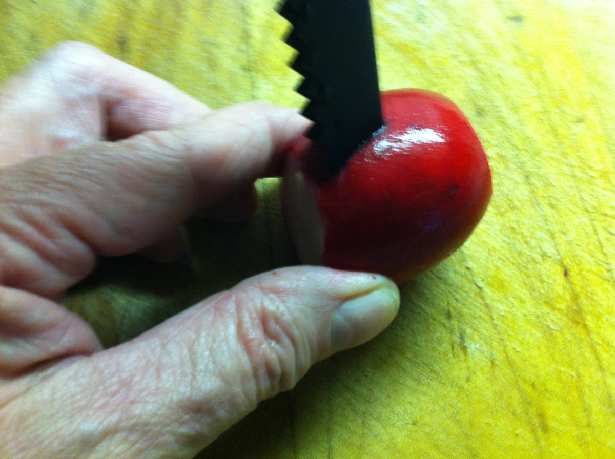 Insert the tool into the radish and push half way through.