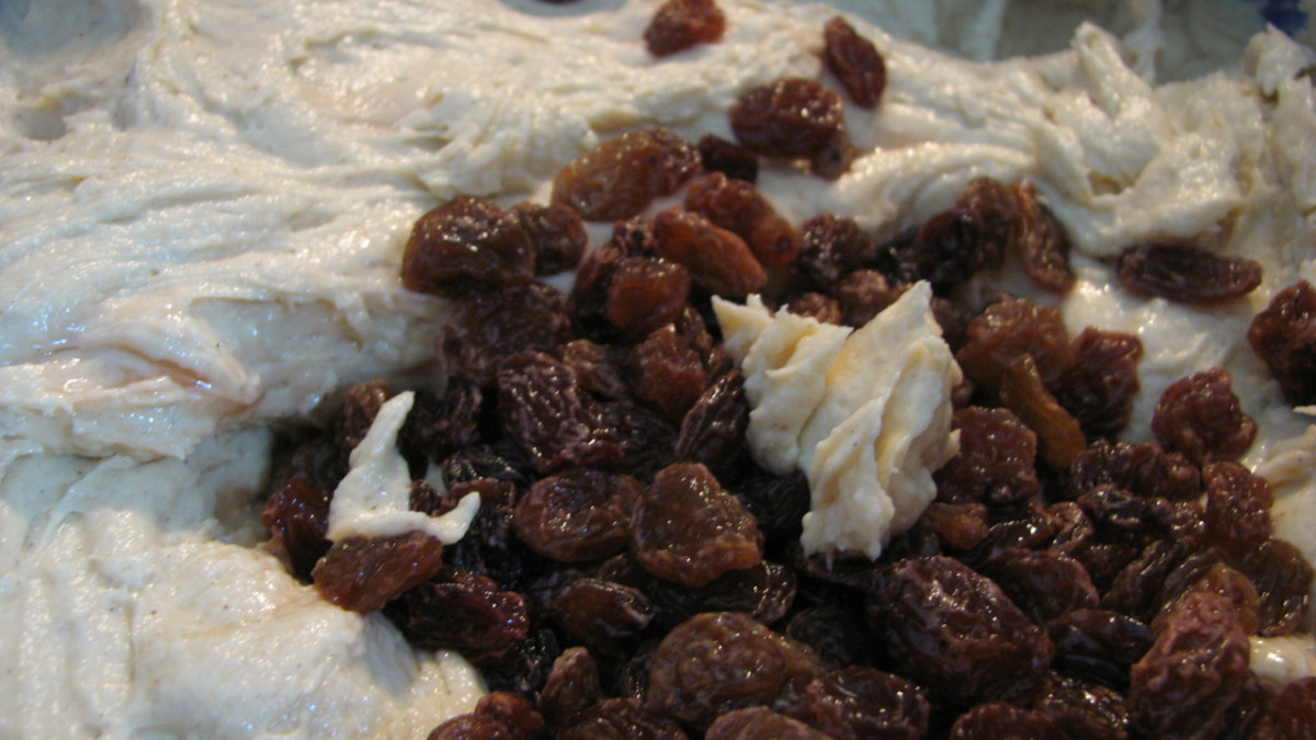 Add the rum-soaked sultanas to the cake batter.