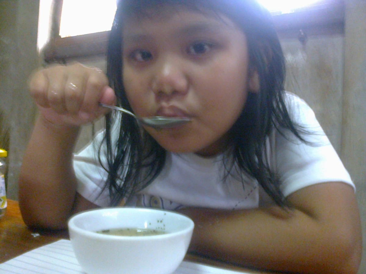My 8-year old daughter ready to taste my home made Malunggay Tea.