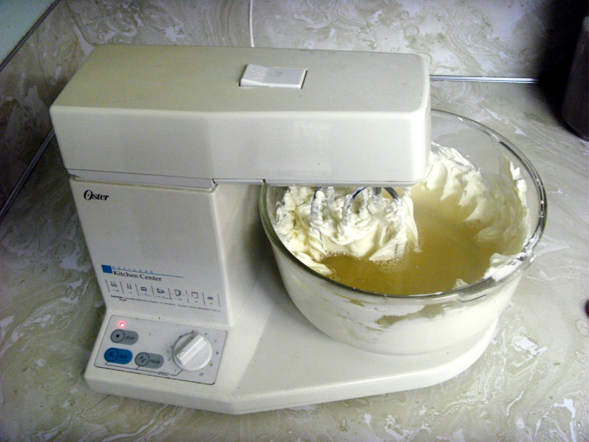 Mixing the gelatin mixture with the cream cheese.  Start with the mixer on slow so that the water isn't thrown out.