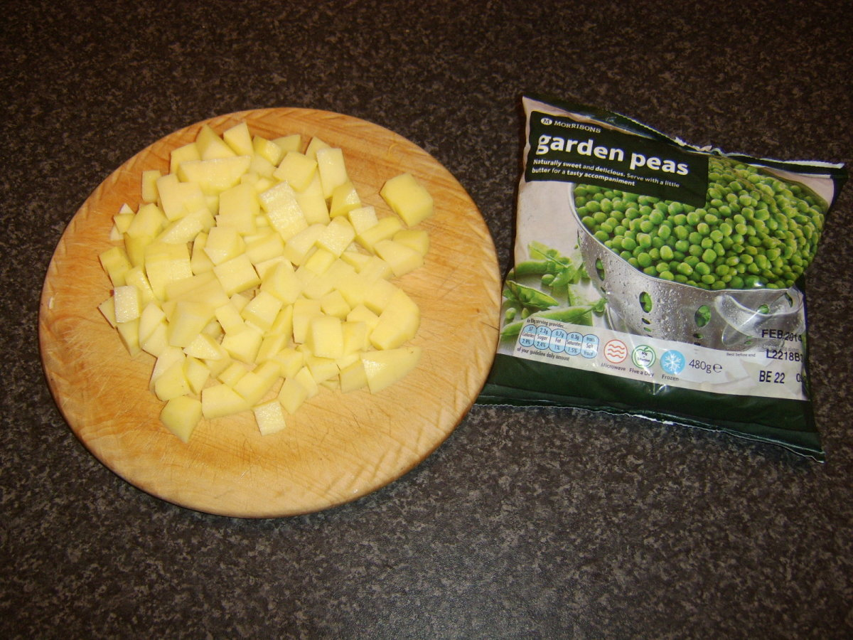 Chopped potatoes and frozen peas for soup