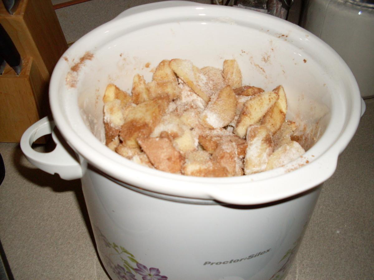 Stir ingredients coating apples.