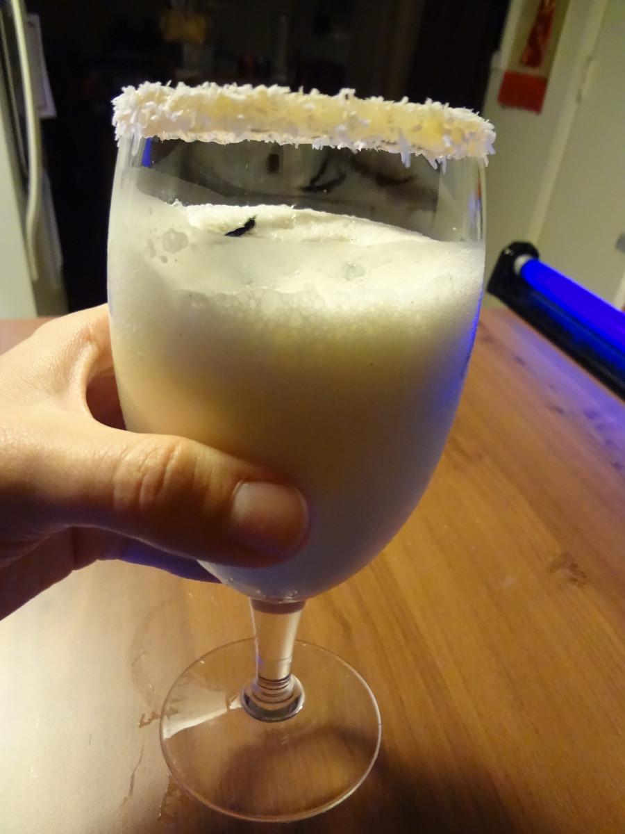 Carefully pour the drink avoiding the rim.