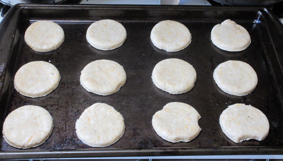 Punch out circles of dough and place them on a greased or nonstick cookie sheet. Mine is old and battered, but it works great!