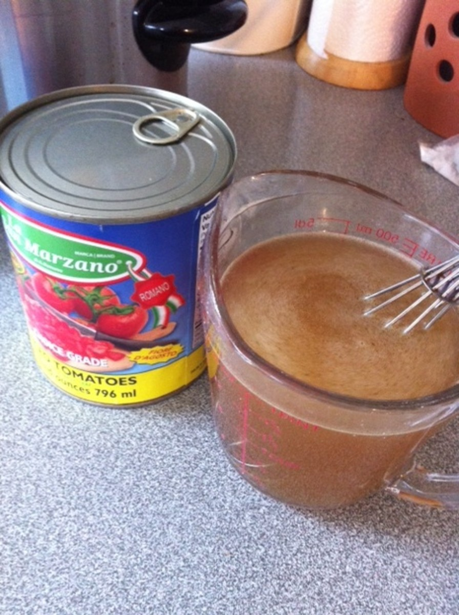 2 cups water with beef bullion cube, and 28 oz canned tomatoes with liquid.