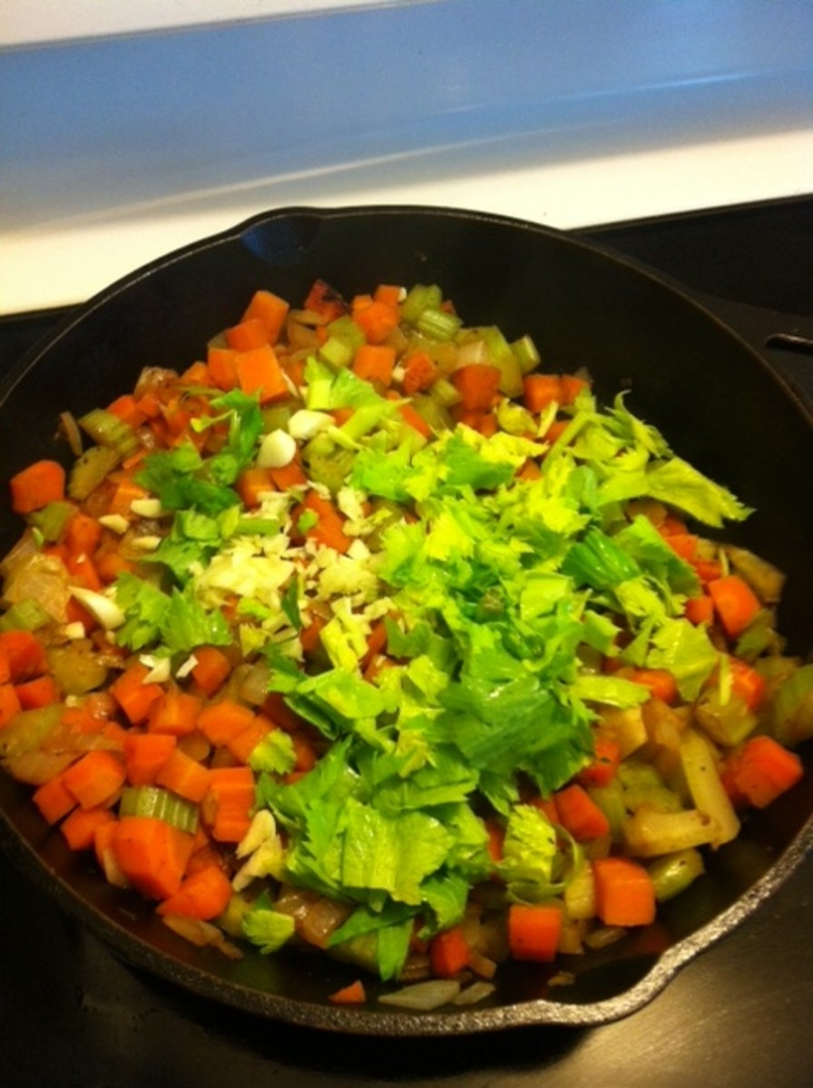 Add the garlic and celery leaves for the last minute.