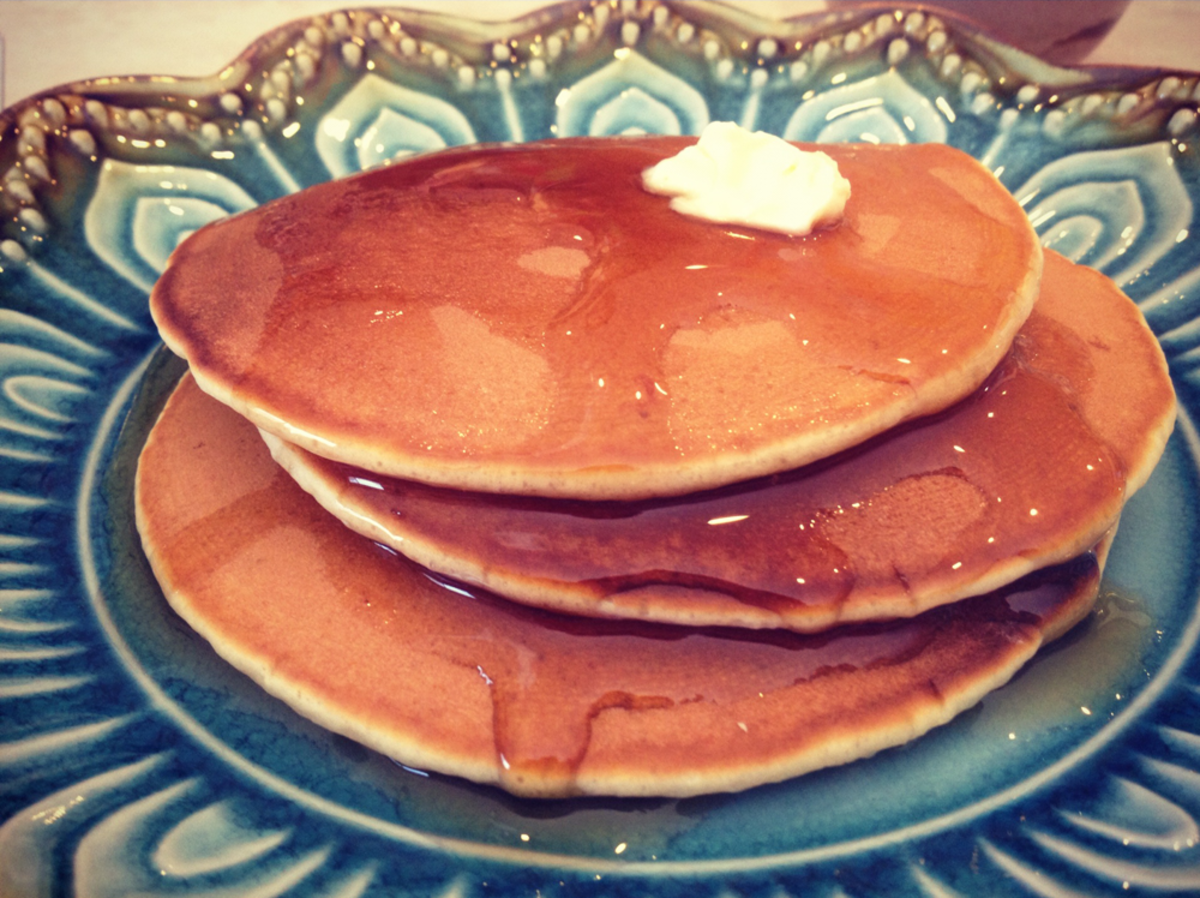 Yogurt pancakes made from scratch with butter and syrup.