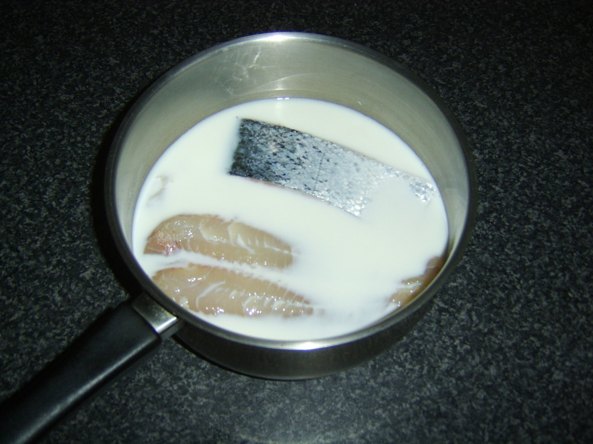 Fish for pie is poached in milk