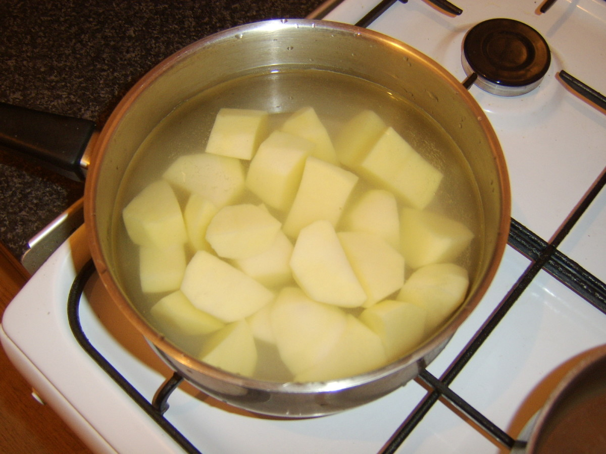 Potatoes are chopped for boiling