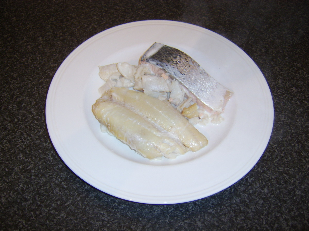 Poached fish is removed from milk