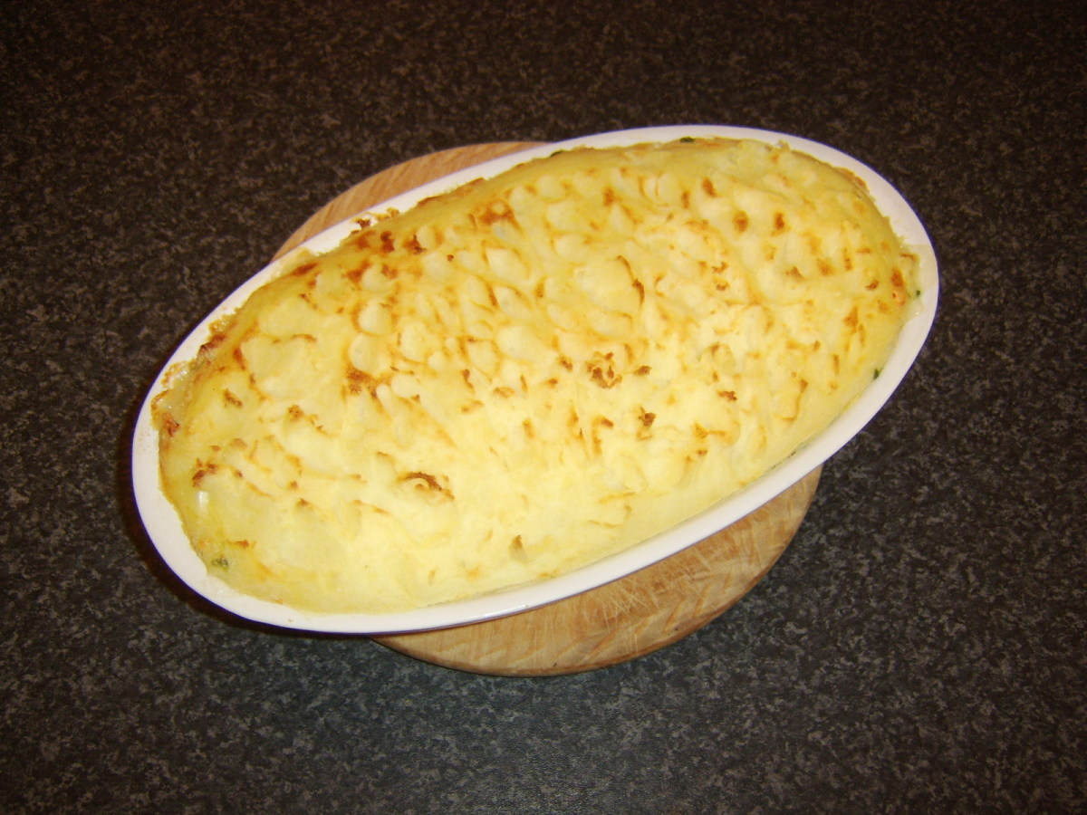The traditional British fish pie has been browned under the grill/broiler